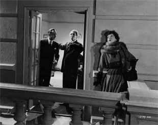 a dramatic scene from the 1949 Take One False Step