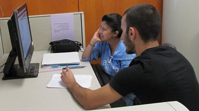 EOPS participant being tutored inside computer lab